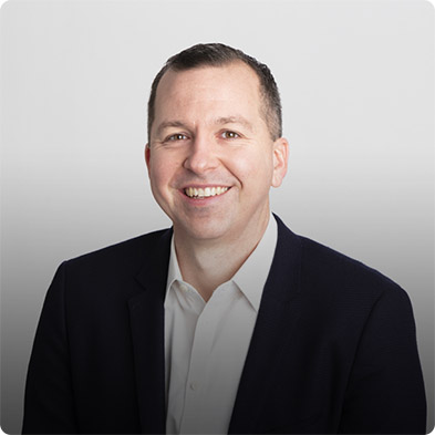 Picture of Glenn Renzulli, Chief Financial Officer of Paya. He is a short haired, smiling man who is clad in a black sports coat with white shirt underneath.